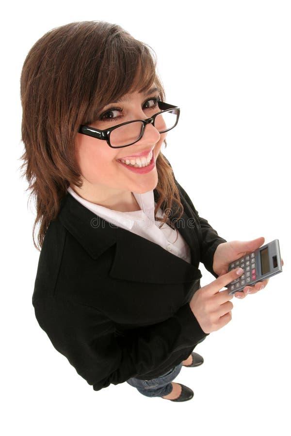 Mulher de negócios que prende uma calculadora foto de stock