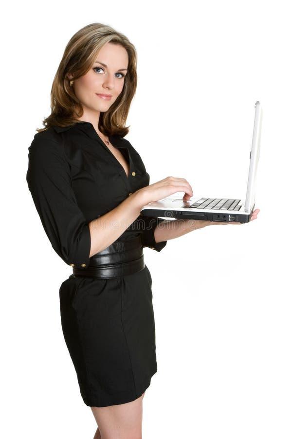 Mulher de negócios que usa o portátil foto de stock royalty free