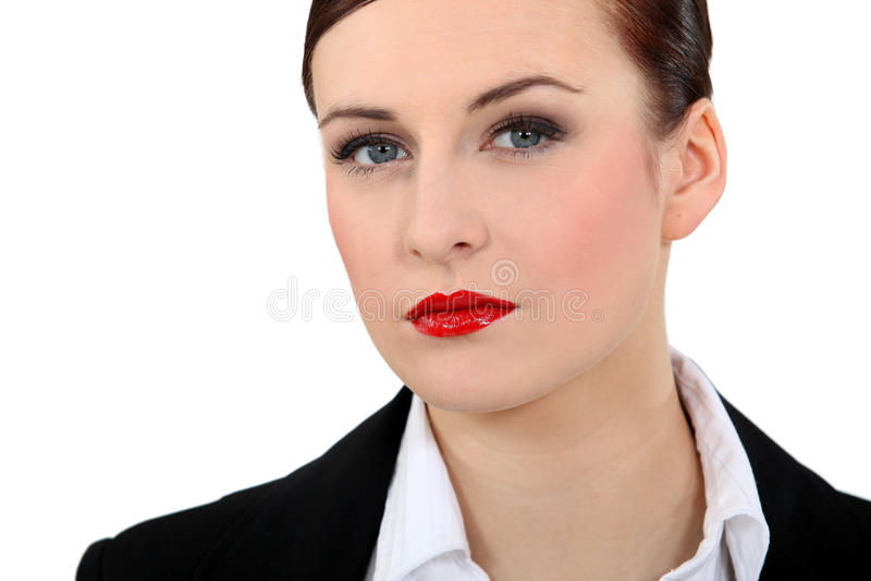 Mulher de negócios que veste o batom vermelho fotografia de stock royalty free