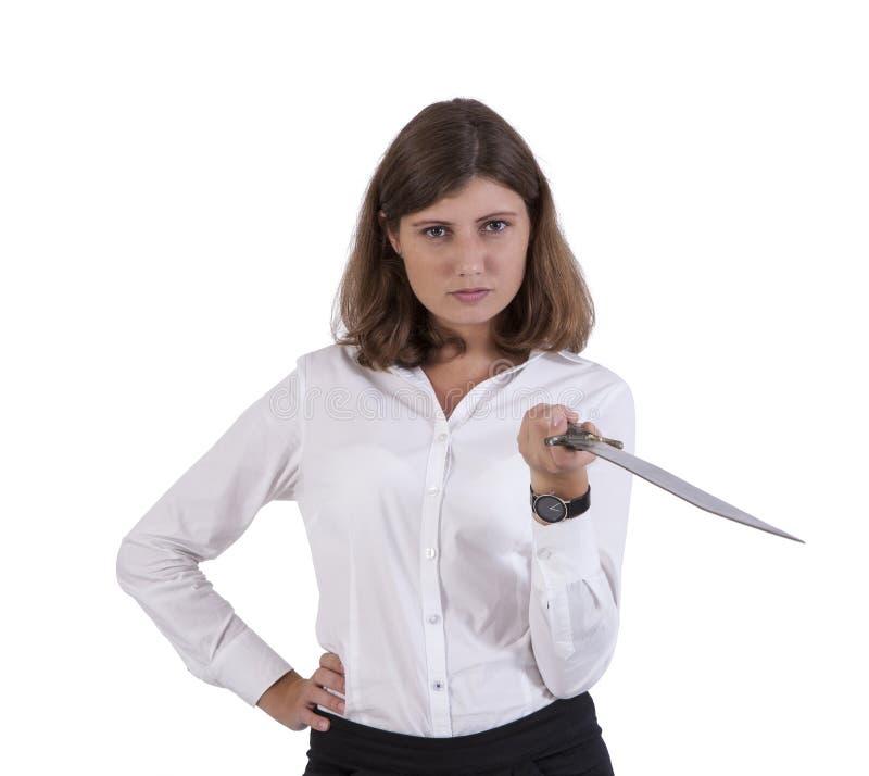 Mulher de negócios séria que levanta com uma espada imagem de stock royalty free