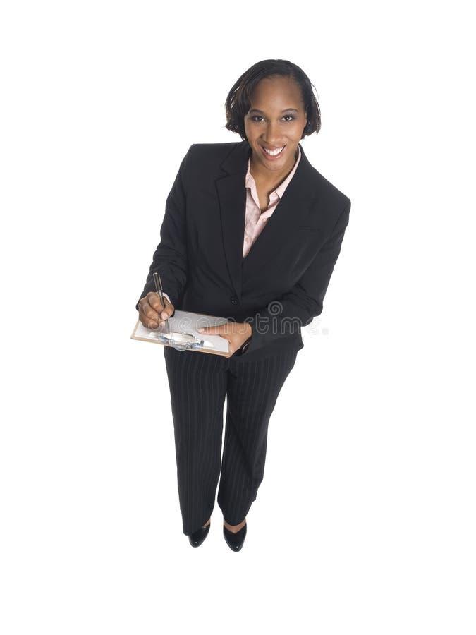 Mulher de negócios - tomando notas fotografia de stock