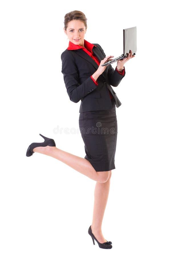 A mulher de negócios trabalha no portátil pequeno, netbook fotos de stock