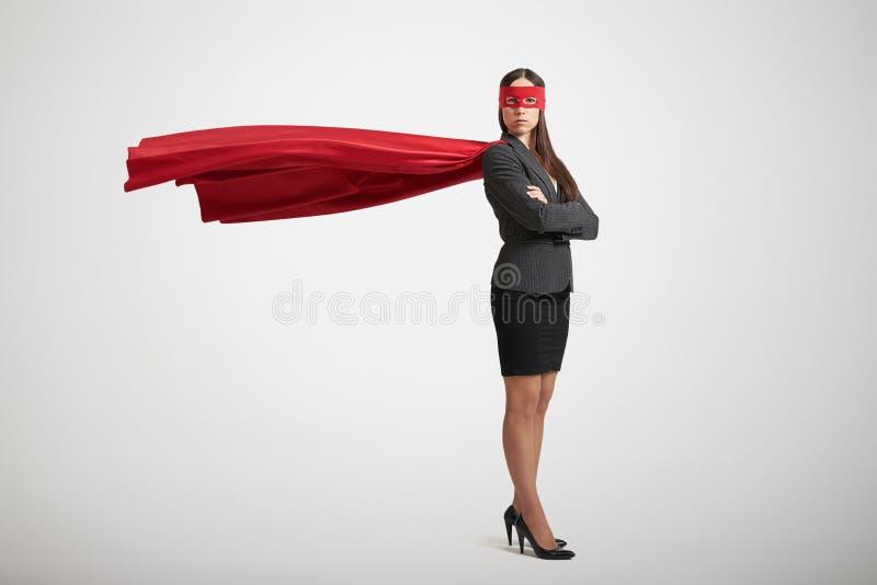 Mulher de negócios vestida como um super-herói imagens de stock royalty free