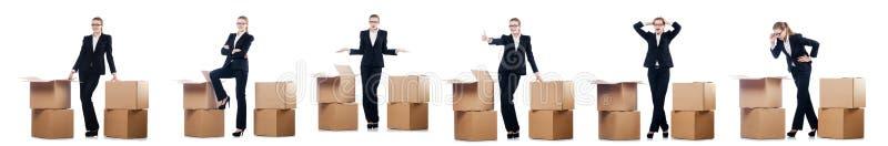 Mulher de neg?cios com as caixas isoladas no branco imagem de stock