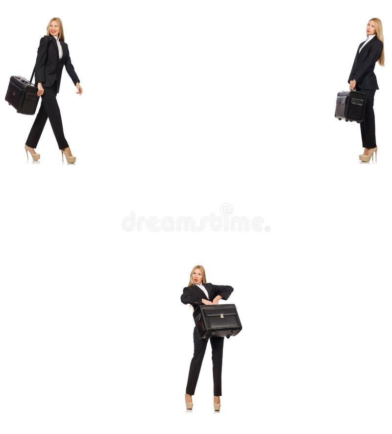 A mulher de neg?cios com a mala de viagem isolada no branco fotos de stock
