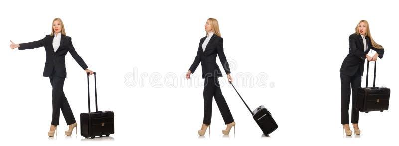 A mulher de neg?cios com a mala de viagem isolada no branco fotografia de stock