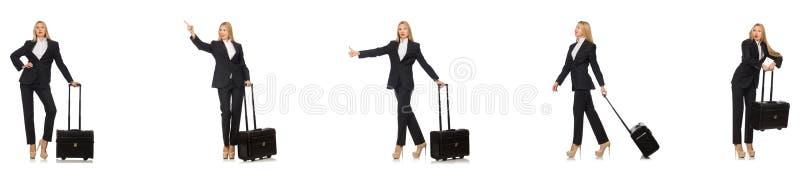 A mulher de neg?cios com a mala de viagem isolada no branco imagem de stock royalty free