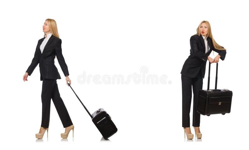 A mulher de neg?cios com a mala de viagem isolada no branco imagens de stock