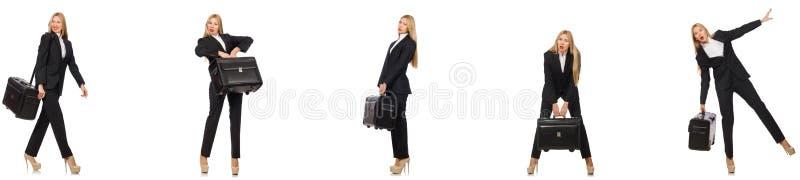 A mulher de neg?cios com a mala de viagem isolada no branco imagem de stock