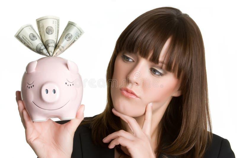 Mulher de pensamento de Piggybank fotos de stock