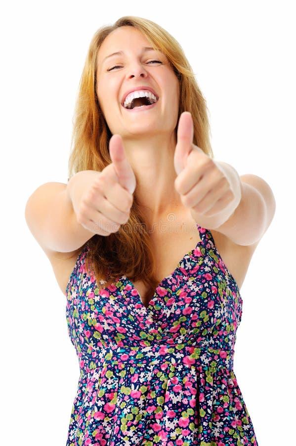 Mulher de riso com dois polegares acima fotos de stock