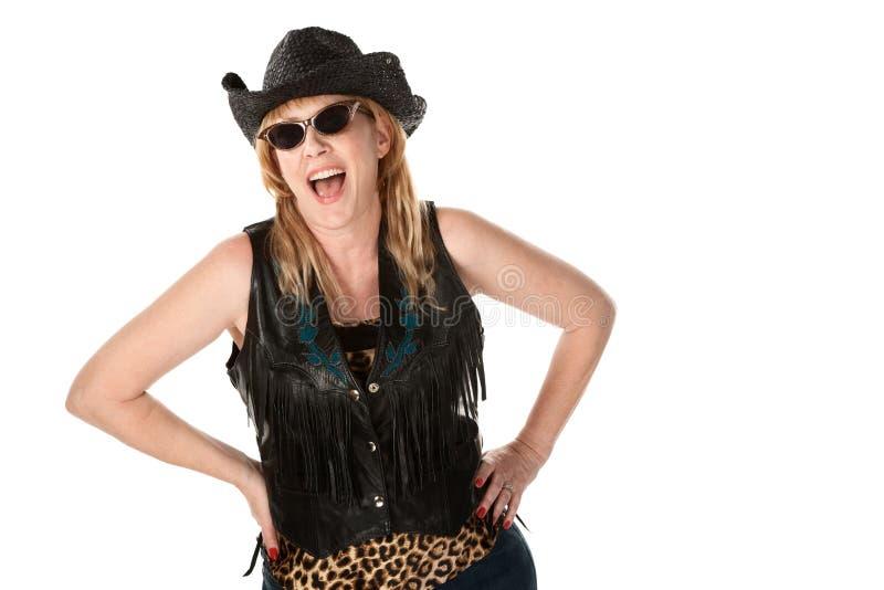 Mulher de riso do motociclista imagens de stock