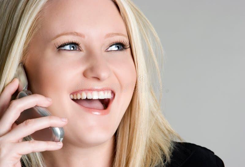 Mulher de riso do telefone foto de stock royalty free