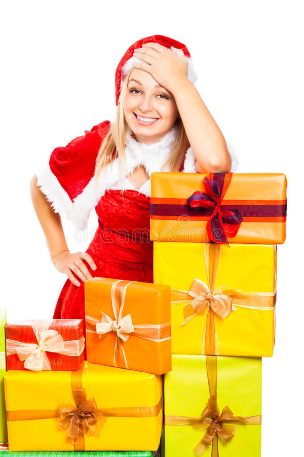 Mulher de Santa e presentes de sorriso do Natal foto de stock