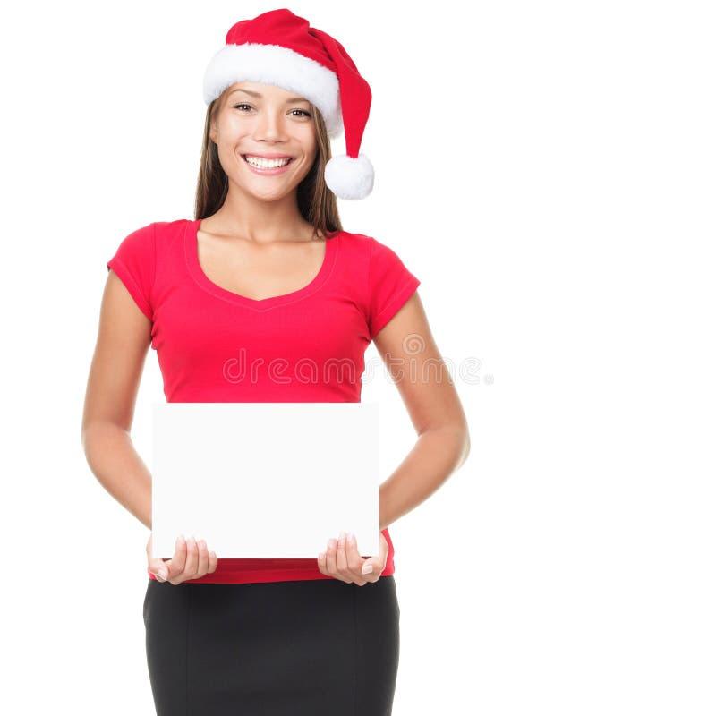Mulher de Santa que mostra o sinal em branco fotografia de stock