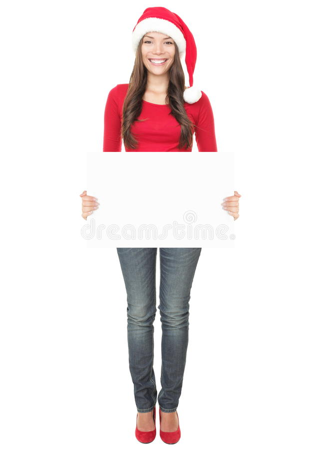 Mulher de Santa que mostra a sinal em branco o comprimento cheio foto de stock royalty free