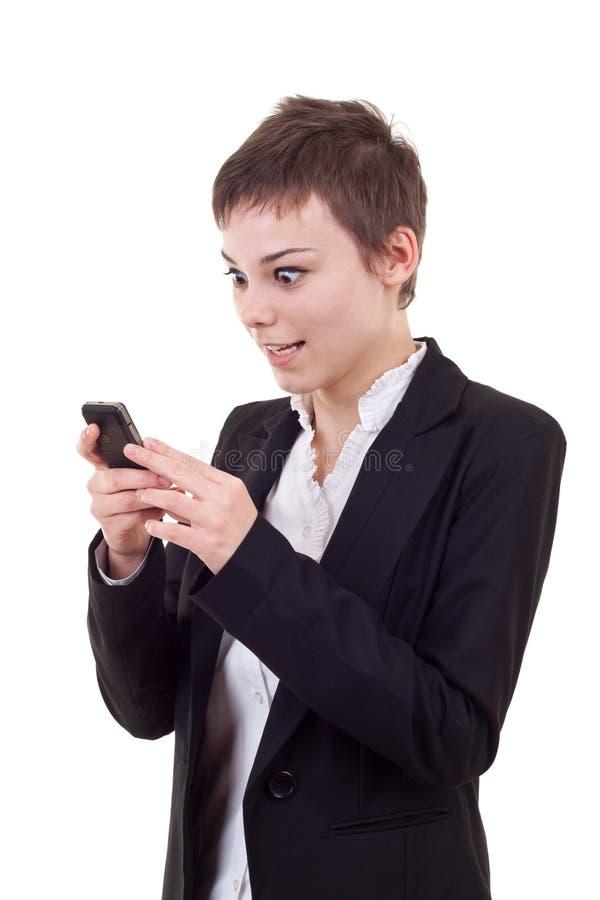 Mulher de Shoked que olha um telefone imagens de stock royalty free