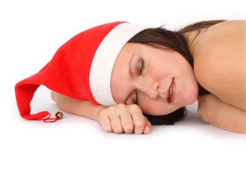 Mulher de sono com chapéu do Natal imagens de stock royalty free