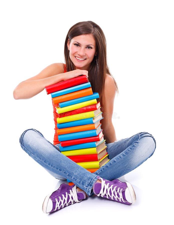 Mulher de sorriso com livros fotografia de stock