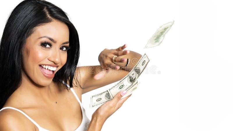 Mulher de sorriso consideravelmente feliz que conta o dinheiro fotografia de stock royalty free