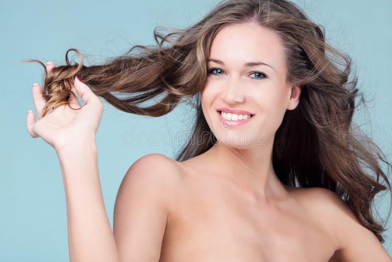 Mulher de sorriso da beleza fotografia de stock