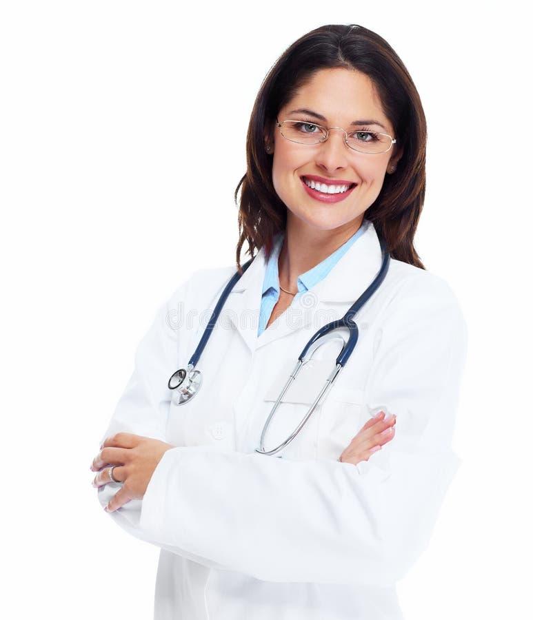 Mulher de sorriso do médico com estetoscópio. fotografia de stock