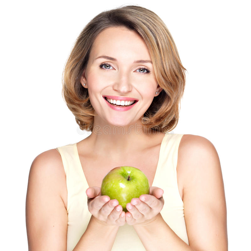 Mulher de sorriso feliz nova com maçã verde. foto de stock royalty free