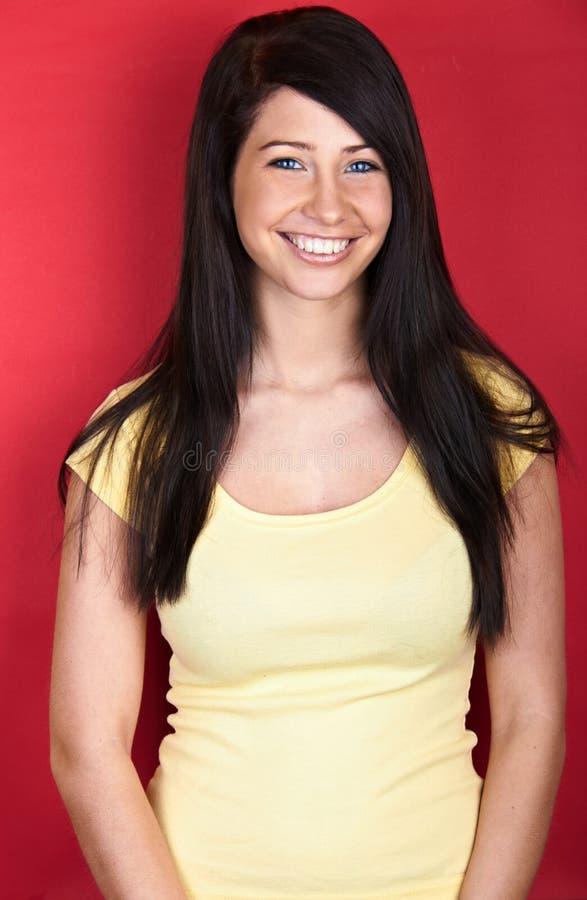 Mulher de sorriso nova fotografia de stock royalty free