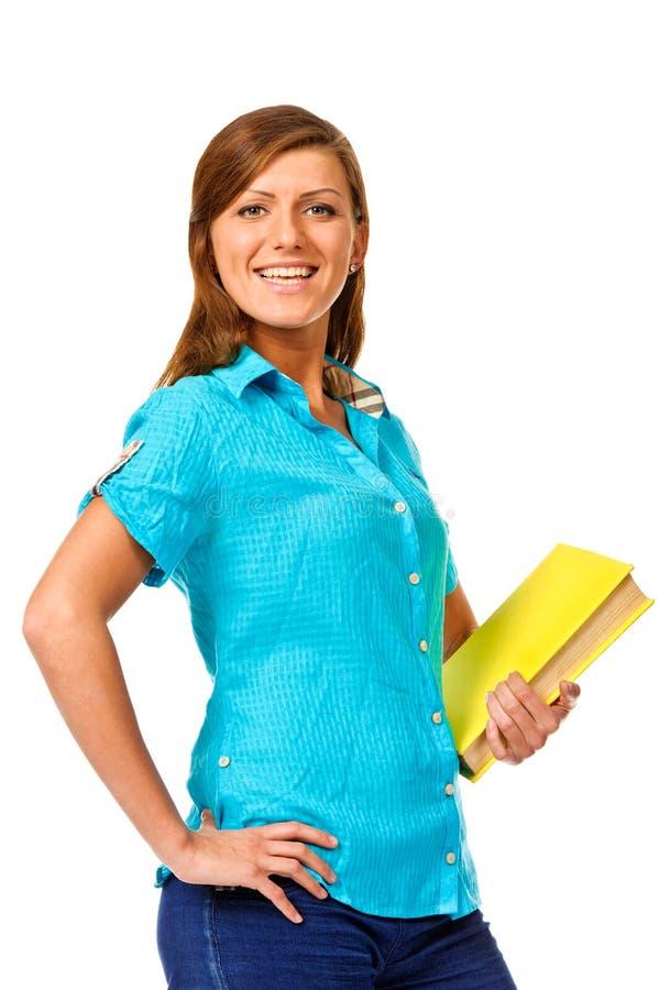Mulher de sorriso nova do estudante com livro. Isolado sobre o branco imagem de stock