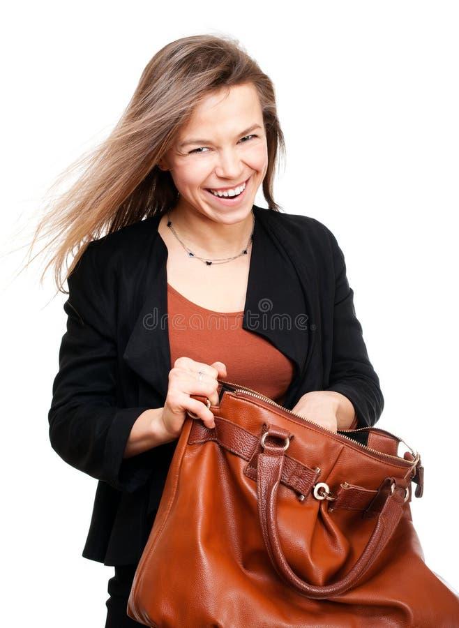 Mulher de sorriso nova que procura em grande imagens de stock royalty free