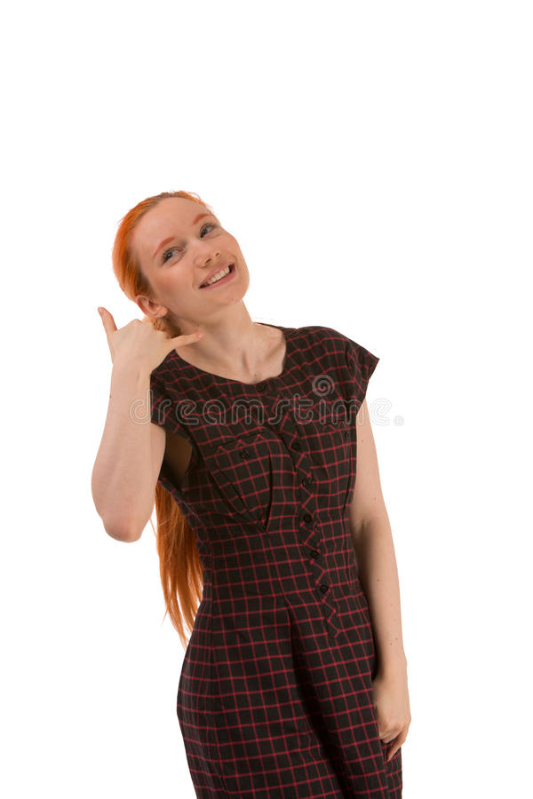 Mulher de sorriso que faz a uma chamada me gesto fotos de stock royalty free