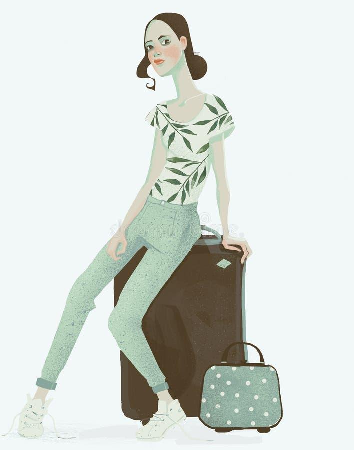 Mulher de viagem nova que senta-se com mala de viagem avante fotografia de stock