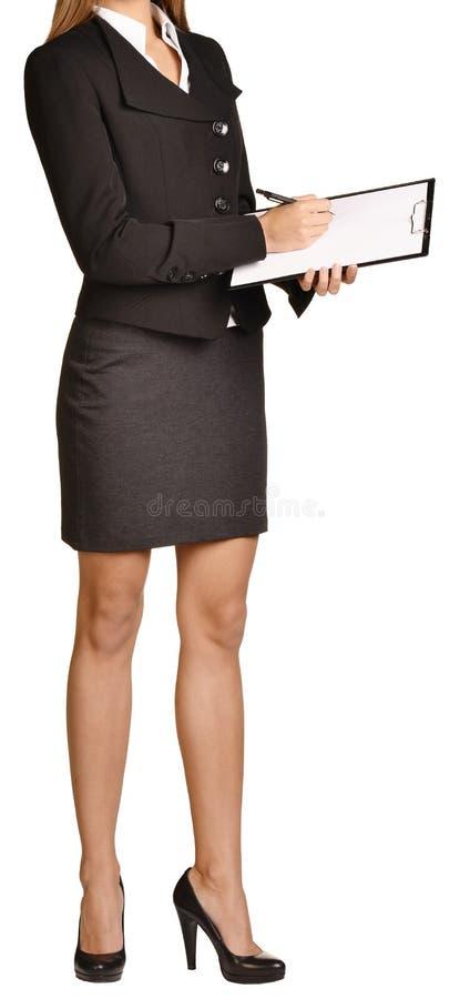 A mulher decapitado escreve a pena de esferográfica em uma prancheta imagens de stock royalty free