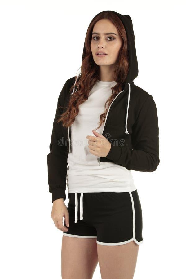 Mulher denominada vintage do ajuste dos esportes que vai ao gym em seu tshirt branco vazio com espaço para seu tipo imagem de stock