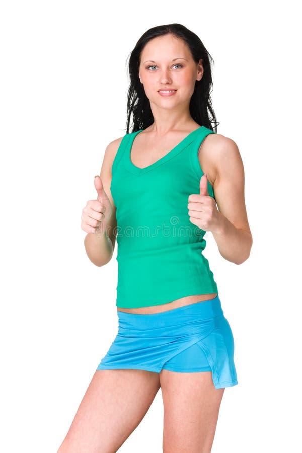Mulher desportiva bonita com polegares acima foto de stock royalty free