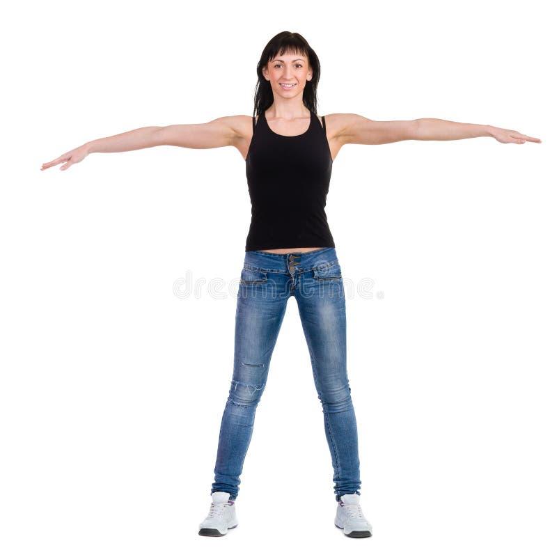 Mulher desportiva bonita que faz o exercício foto de stock