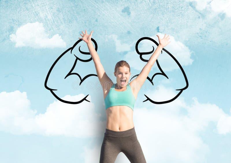 mulher desportiva nova feliz que salta na frente dos punhos na tração do céu em uma parede foto de stock