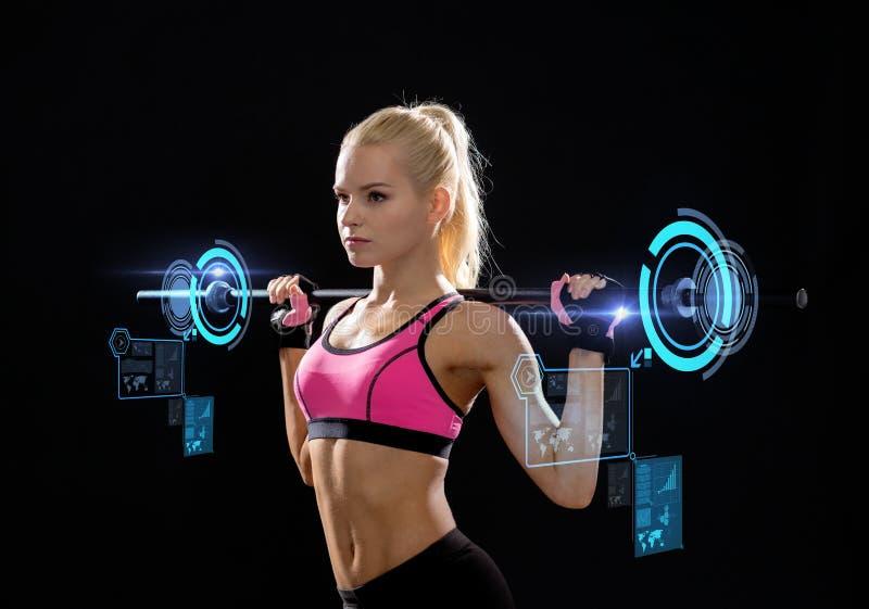 Mulher desportiva que exercita com barbell imagem de stock royalty free