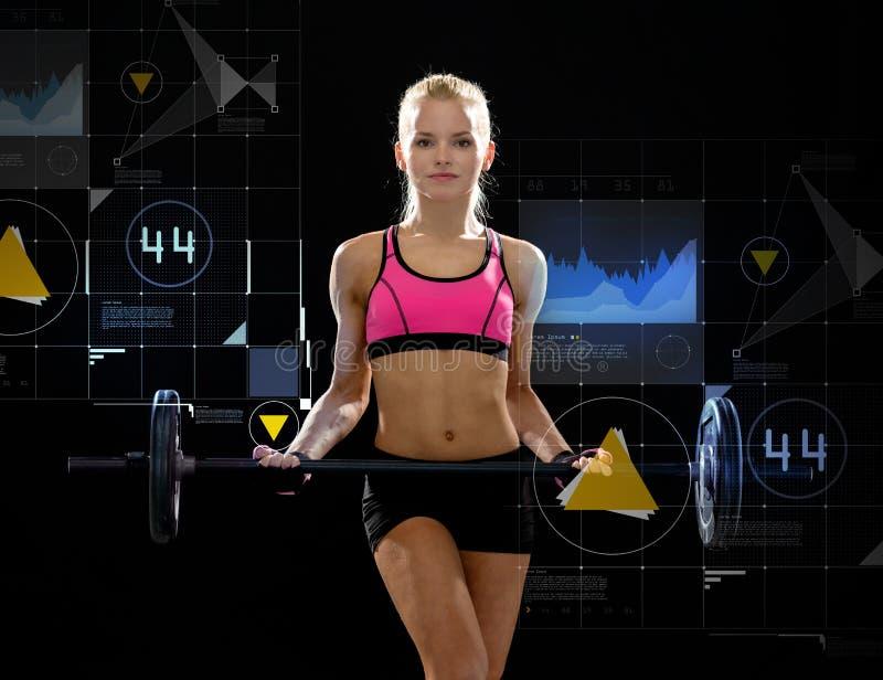 Mulher desportiva que exercita com barbell fotos de stock royalty free