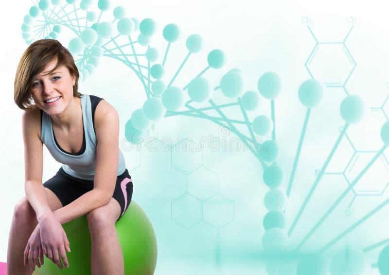 mulher desportiva que senta-se em uma bola com a corrente azul do ADN foto de stock royalty free