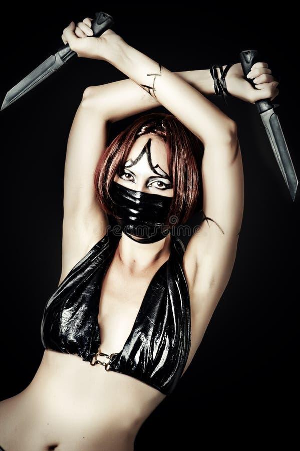 Download Mulher do assassino imagem de stock. Imagem de faca, menina - 26515121