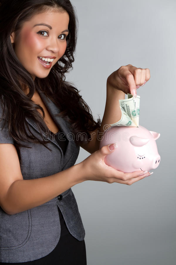 Mulher do banco Piggy foto de stock royalty free
