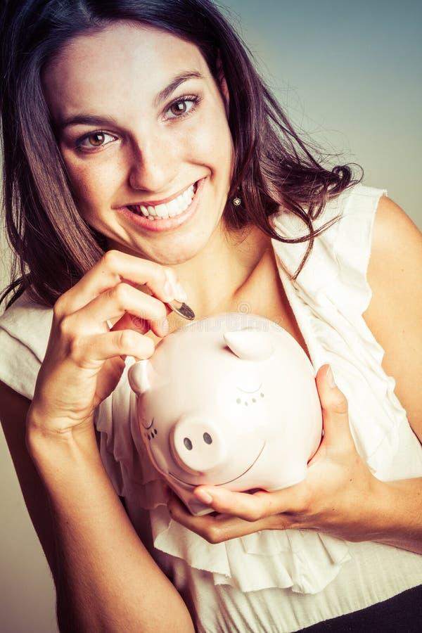 Mulher do banco Piggy fotografia de stock royalty free