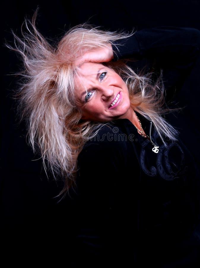 Mulher do blonde do sorriso. imagens de stock royalty free