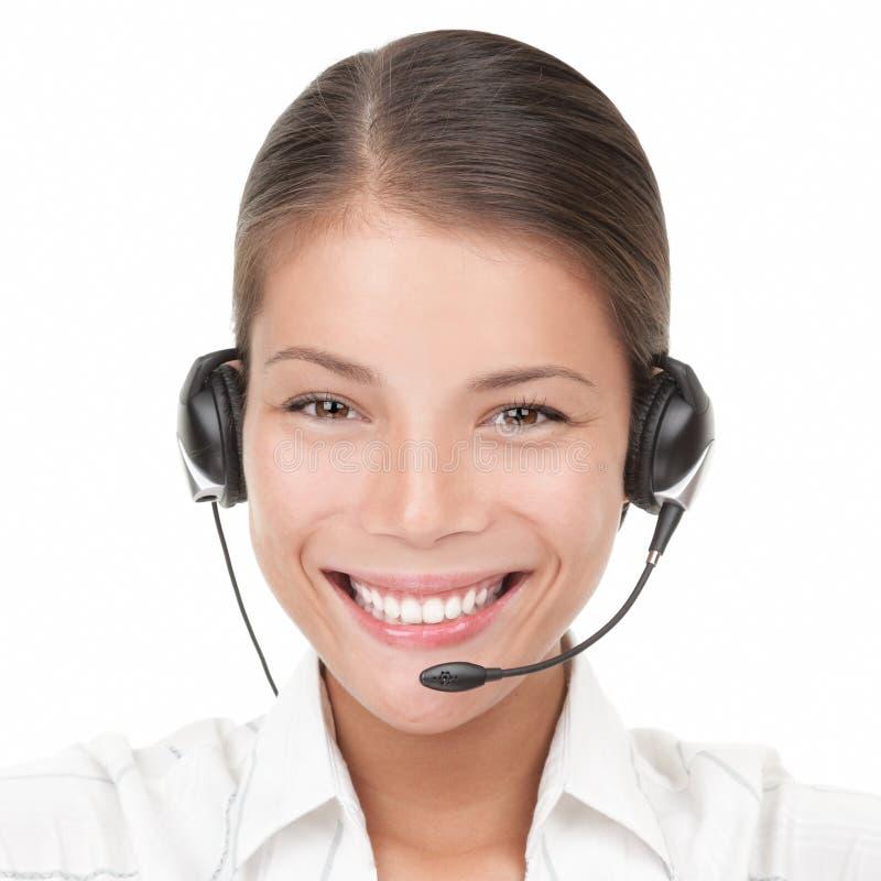 Mulher do centro de chamadas com auriculares imagem de stock