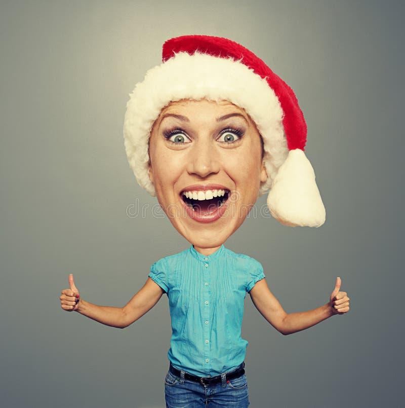 Mulher do convencido no chapéu de Santa imagens de stock