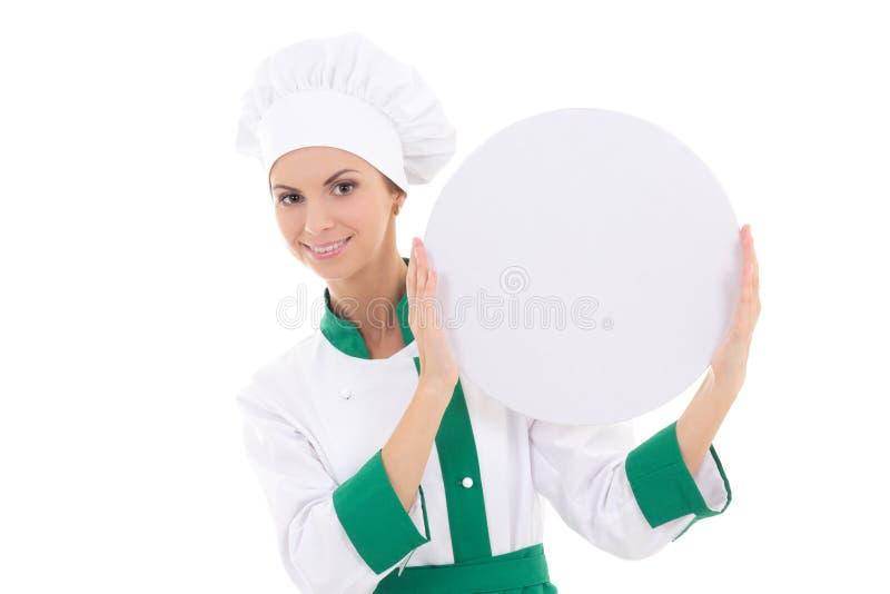 Mulher do cozinheiro chefe no uniforme que guarda a placa vazia grande com espaço da cópia mim fotos de stock