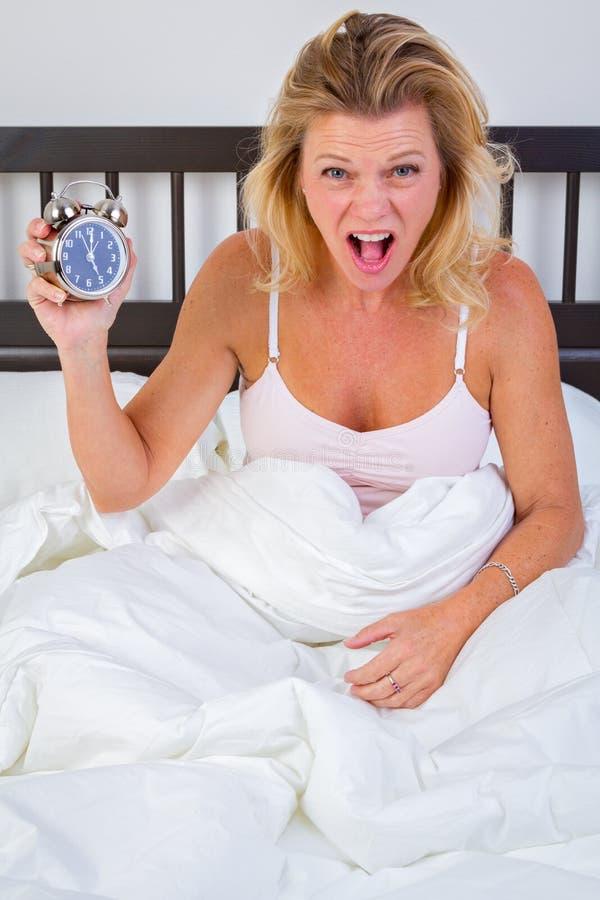 Mulher do despertador fotografia de stock royalty free