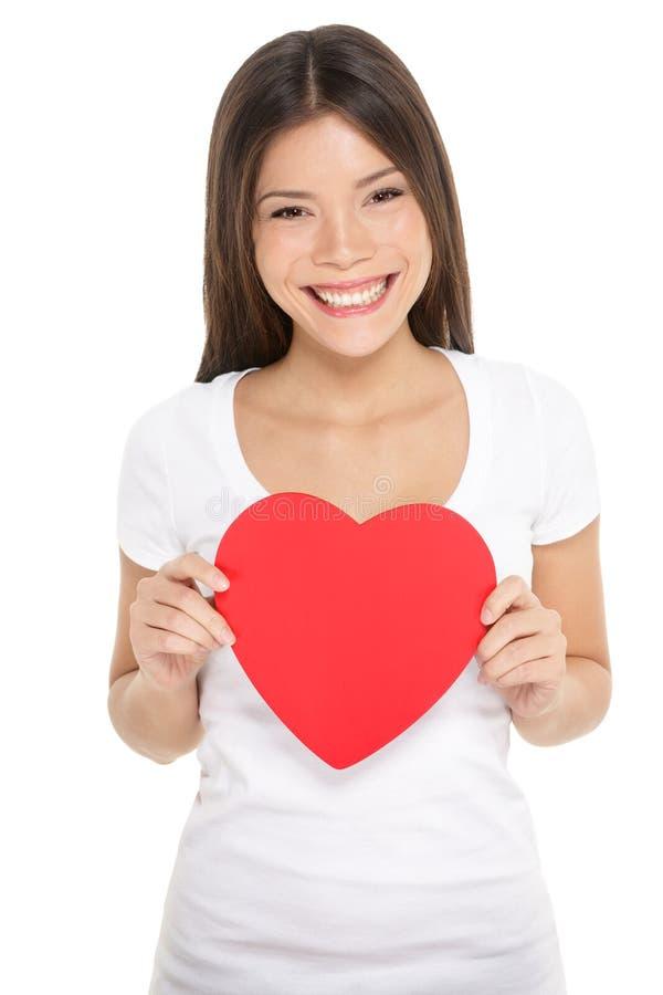 Mulher do dia de Valentim que mantem o coração isolado fotos de stock