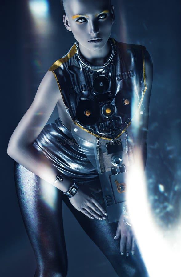 Mulher do espaço que levanta no sumário claro fotografia de stock royalty free